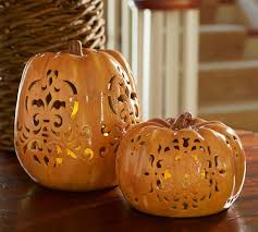 ceramic pumpkins punched ceramic pumpkin luminaries pottery barn