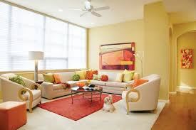 nice khaki wall paint color background with round glass table plus