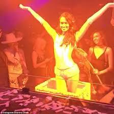 shanina shaik jumps out of birthday cake for dj rukus daily mail