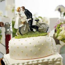 and groom wedding cake toppers bicycle and groom on a bike wedding cake topper