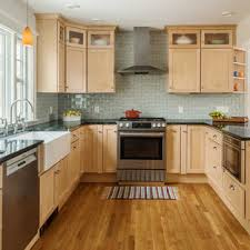 light wood kitchen cabinets with black countertops 75 beautiful kitchen with light wood cabinets and soapstone