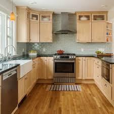 what backsplash goes with light wood cabinets 75 beautiful kitchen with light wood cabinets and soapstone