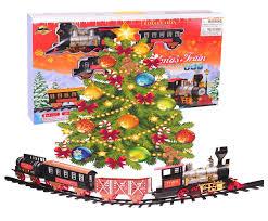 northern express christmas train set around the tree holiday