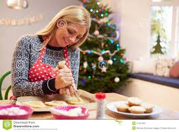 family exchanging gifts by christmas tree stock photo image