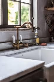 brass faucets kitchen vignette design brass or chrome