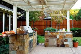outdoor kitchen design with covered pergola for awesome look