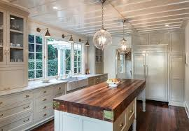 Farmhouse Style Pendant Lighting Cottage Kitchen With Farmhouse Sink Wood Counters In Santa