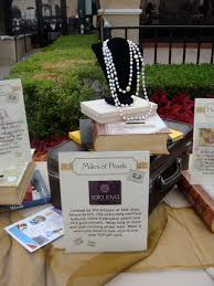 silent auction table decor books and suitcases add height to