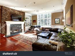 Luxury Livingrooms Luxury Living Room Stone Fireplace Leather Stock Photo 123343030