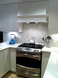 backsplash calcutta marble in a herringbone pattern cabinets are