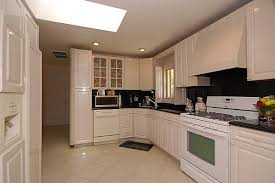 white cabinets with white appliances matching appliances to your kitchen do s and don ts white