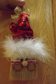 homemade christmas ornament santa claus made from a paint brush