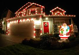 pictures of homes decorated with christmas lights throughout house
