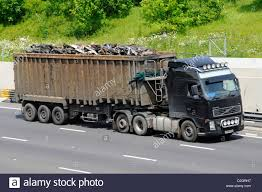 volvo lorries uk scrap metal load on articulated trailer behind a volvo lorry stock