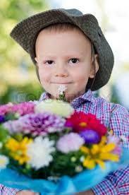 Flowers For Mum - little boy with flowers for mum stock photo colourbox