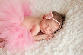 newborn baby pictures newborn baby girl wearing a pink tutu stock photo picture and