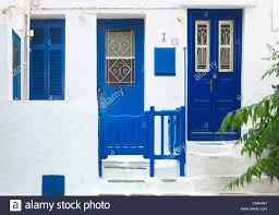 blue doors and white washed walls on the streets of mykonos