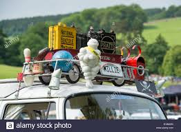 Retro Camper Retro Collectibles On The Roof Rack Of A Volkswagen Camper Van At