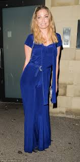 blue velvet jumpsuit harding wows in a figure hugging blue velvet jumpsuit as she