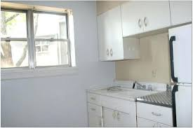 repainting metal kitchen cabinets how to paint metal kitchen cabinets purplebirdblog com