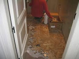 mc escher inspired interlocking wooden floor lizards geekologie