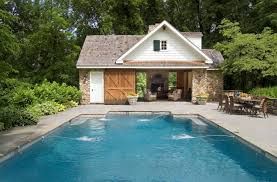 pool house modeled after a 9th century colonial farmhouse look at