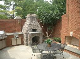 Outdoor Kitchen Designs With Pizza Oven by Round Stone Outdoor Fireplace Fireplaces Pinterest Outdoor