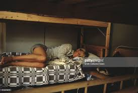 Sleeping In A Chair Woman Sleeping In Bunk Bed Pictures Getty Images