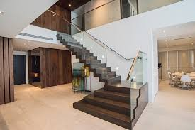 contemporary stair renovation grande foyer in aventura home