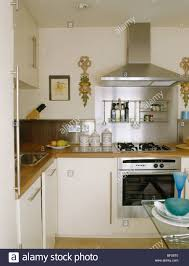 modern cream kitchens small modern cream kitchen with stainless steel extractor above
