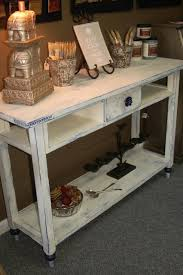 distressed white side table white sofa table toulouse white coffee table loz exclusive to dunelm