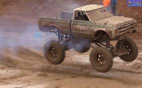 monster trucks videos in mud monster truck photo album