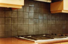 decor tips interesting copper backsplash for kitchen design backsplash behind stove with cooktop and downdraft also copper backsplash with granite countertops and kitchen cabinet