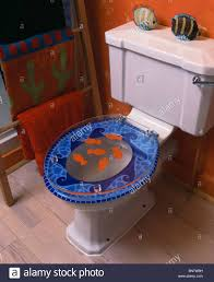 themed toilet seats up of toilet with novelty fish themed perspex toilet seat in
