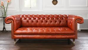 Red Leather Chesterfield Sofa by Catchy White Wall Panel Background Designed Behind Maroon Leather
