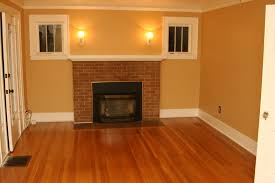 Laminate Floor Offers Brown Wooden Laminate Floor And Brick Fireplace Connected By