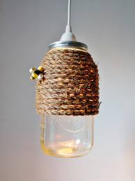 Jelly Jar Light With Cage by Turning Mason Jars Into Light Fixtures