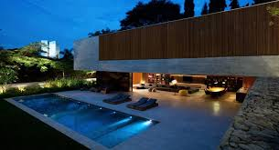 luxury modern home design with small pool and concrete decking