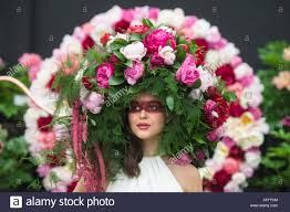 floral headdress a model wears a bespoke peony floral headdress on the primrose