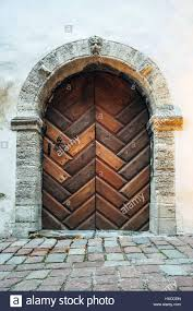 style front door medieval wooden stone arch building paved spanish