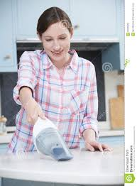 Cleaning Kitchen Woman Cleaning Kitchen Using Hand Held Vacuum Cleaner Stock Photo