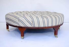 large round tufted ottoman with striped upholstery at 1stdibs