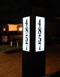 light up address sign qualarc edgewood large lighted address plaque hayneedle with solar