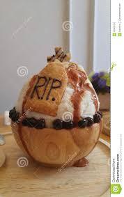 milk tea bingsu desert with caramel syrup on halloween decoration