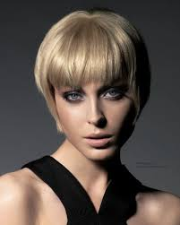 how to cut hair with a weight line retro pixie with tapering and a weight line along the top of the ears