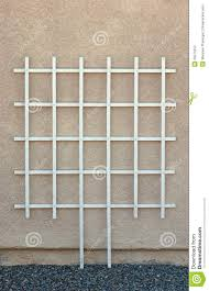empty white garden trellis against wall stock image image 25071813