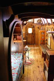 a 204 square tiny house with carved interior woodwork