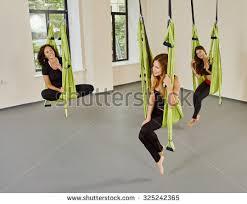 young women posing antigravity aerial yoga stock photo 343516457