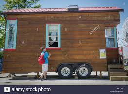 vancouver canada 20th may 2017 a boy looks at a tiny house