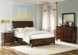 transitional king sleigh bed with 2 drawer storage footboard by